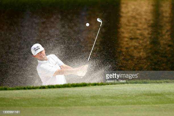 Chez Reavie of the United States plays a shot from a greenside bunker on the 15th hole during the second round of the Wyndham Championship at...