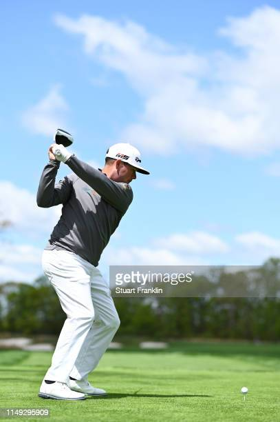 Chez Reavie of the United States plays a shot from the 12th tee during a practice round prior to the 2019 PGA Championship at the Bethpage Black...