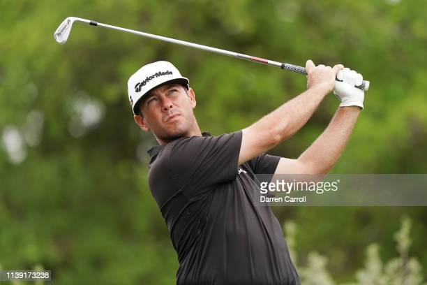 Chez Reavie of the United States plays his shot from the 12th tee in his match against Branden Grace of South Africa during the third round of the...