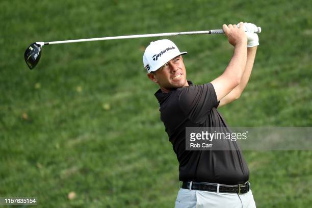 Chez Reavie of the United States plays his shot from the 15th tee during the third round of the Travelers Championship at TPC River Highlands on June...