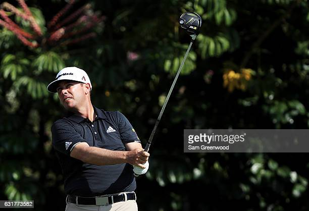 Chez Reavie of the United States plays his shot from the fifth tee during the final round of the Sony Open In Hawaii at Waialae Country Club on...