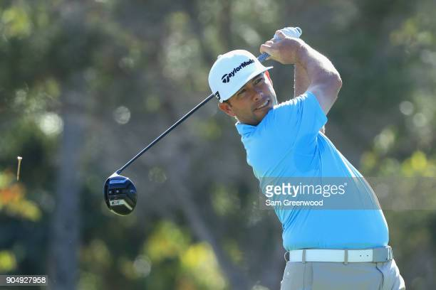 Chez Reavie of the United States plays his shot from the first tee during the final round of the Sony Open In Hawaii at Waialae Country Club on...