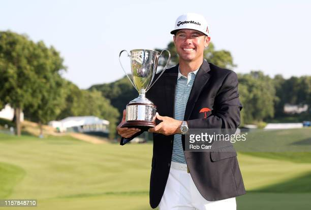 Chez Reavie of the United States poses with the trophy after winning the Travelers Championship at TPC River Highlands on June 23 2019 in Cromwell...