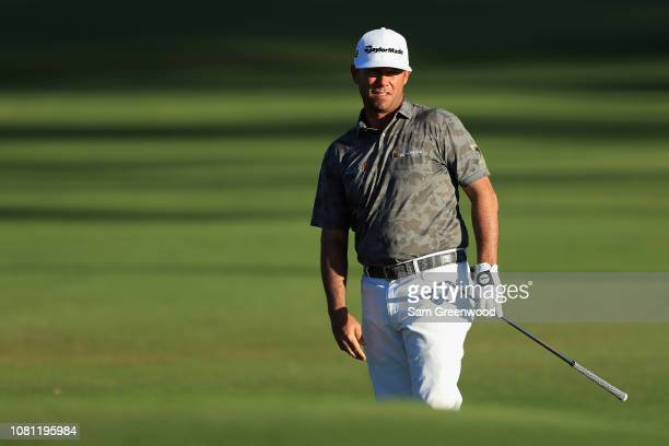 Chez Reavie of the United States reacts to a shot on the 13th hole during the second round of the Sony Open In Hawaii at Waialae Country Club on...