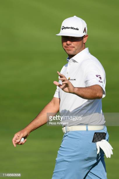 Chez Reavie of the United States waves after chipping in for birdie on the first hole during the first round of the 2019 PGA Championship at the...