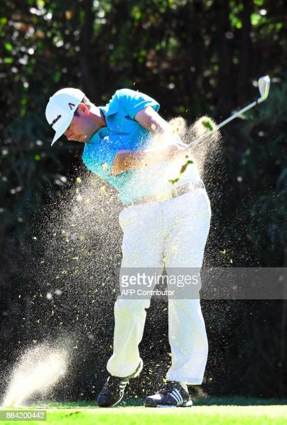 Chez Reavie of the US tees off on the 7th hole during the third round of the CJ Cup at Nine Bridges in Jeju Island on October 21 2017 / AFP PHOTO /...