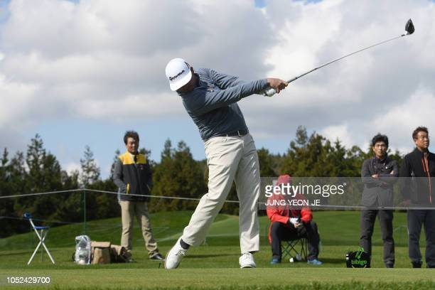 TOPSHOT Chez Reavie of the US tees off on the ninth hole during the first round of the CJ Cup golf tournament at Nine Bridges golf club in Jeju...