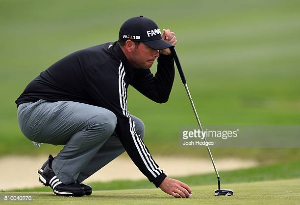 Chez Reavie places his ball on the first green during round three of the ATT Pebble Beach National ProAm at the Spyglass Hill Golf Course on February...