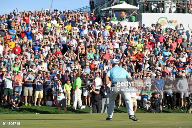 Chez Reavie reacts after making a birdie on the 18th hole during the final round of the Waste Management Phoenix Open at TPC Scottsdale on February 4...