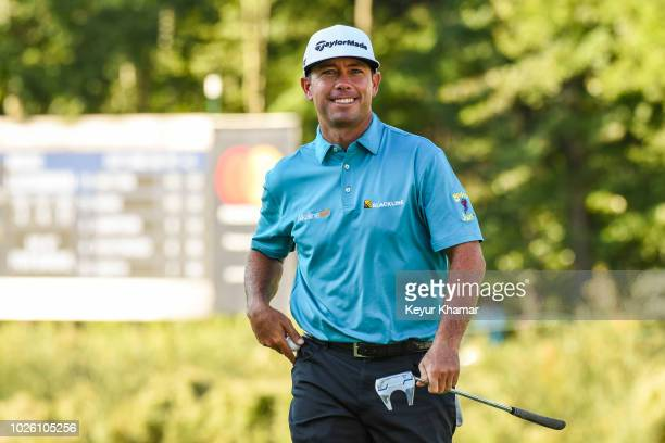 Chez Reavie smiles after making a birdie putt on the 16th hole green during the second round of the Dell Technologies Championship at TPC Boston on...
