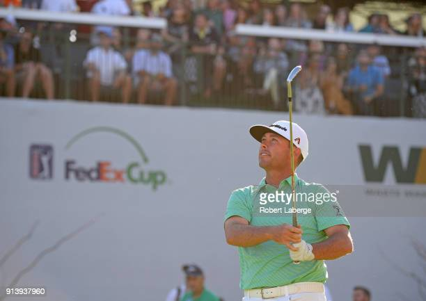 Chez Reavie watches his tee shot on the 16th hole during the third round of the Waste Management Phoenix Open at TPC Scottsdale on February 3 2018 in...