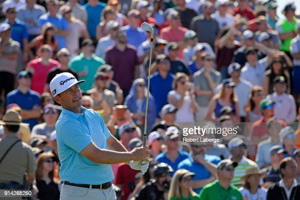 Chez Reavie watches his tee shot on the seventh hole during the final round of the Waste Management Phoenix Open at TPC Scottsdale on February 4 2018...