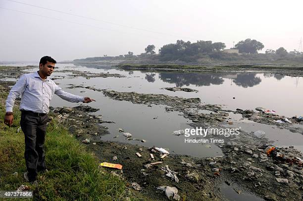 Chhath devotee inspecting the bank of Yamuna river to start the preparations for the Chhath Puja on November 16 2015 in Noida India They are unhappy...
