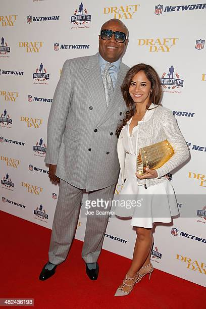 Chi and Julissa McBride arrive at the charity screening of Draft Day at Big Newport Theater on April 3 2014 in Newport Beach California