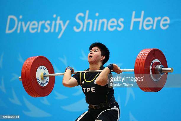Chi Ling Yao of Chinese Taipei competes in the Women's 75kg Weightlifting Final during day six of the 2014 Asian Games at Moonlight Festival Garden...