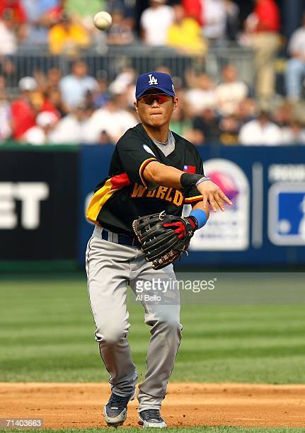 Chi Lung Hu of the World Team throws to first during a game against the U.S.A. Team during the XM Satellite Radio All-Star Futures Game at PNC Park...