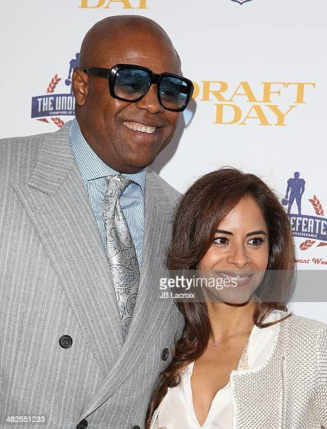 Chi McBride and Julissa McBride arrive at the charity screening of 'Draft Day' at Big Newport Theater on April 3 2014 in Newport Beach California