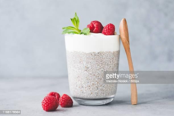 chia pudding parfait with yogurt and raspberries - トロピカルフルーツ ストックフォトと画像