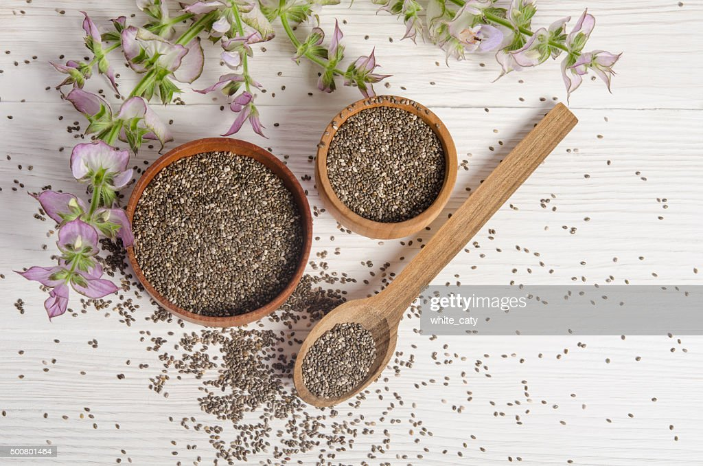 Chia seed healthy super food with flower over white : Stock Photo