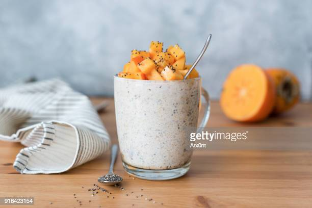 chia seed pudding with persimmon in glass - porzione di cibo foto e immagini stock