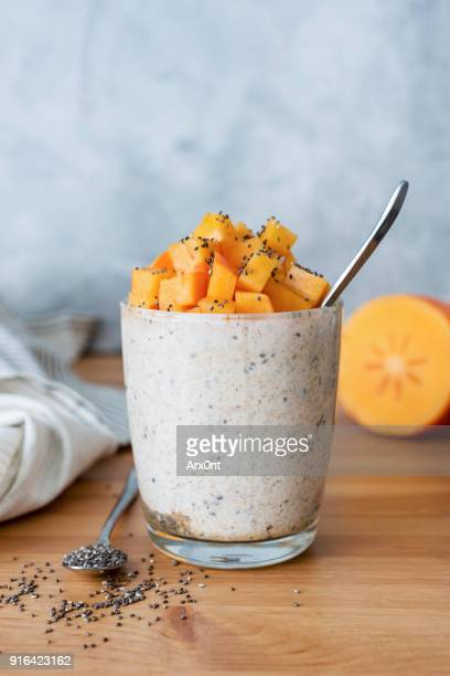 chia seed pudding with persimmon in glass - トロピカルフルーツ ストックフォトと画像