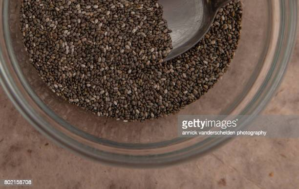 Chia seeds in a glass bowl.