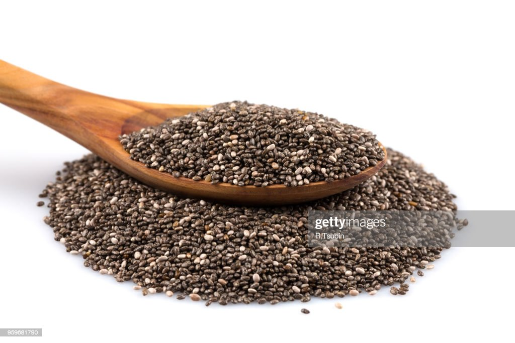 Chia seeds in wooden spoon on white background : Stock-Foto