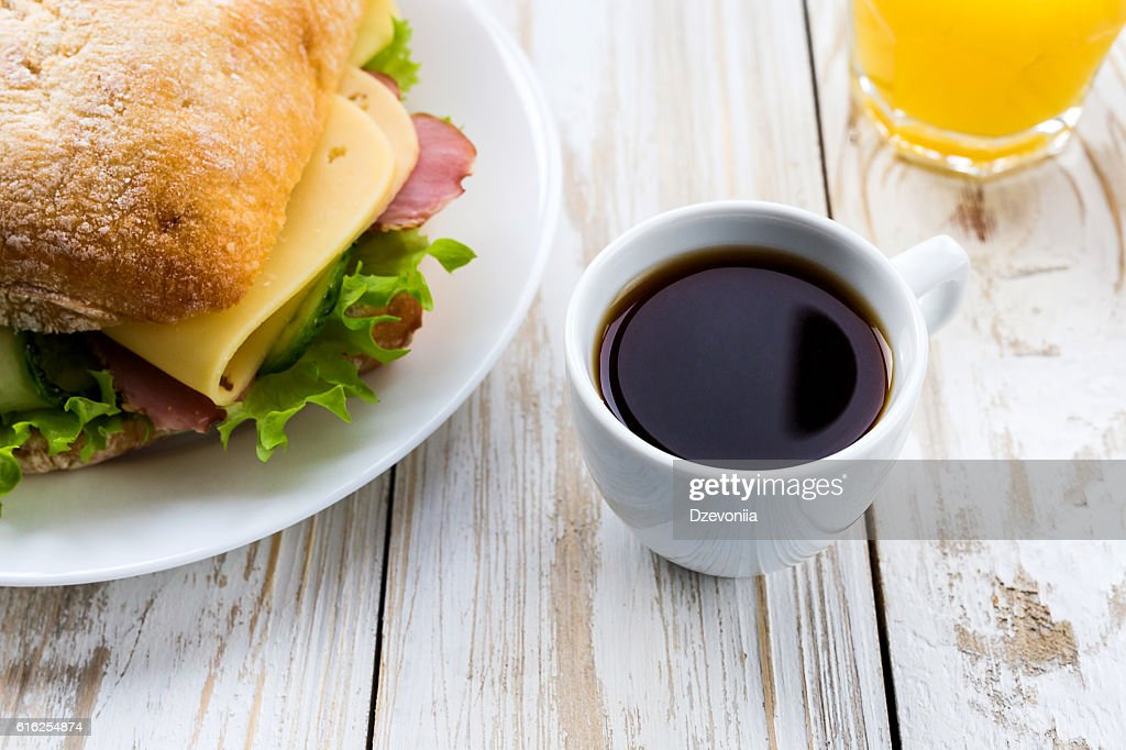 Chiabatta sandwich, cup of coffee and orange juice : Foto de stock