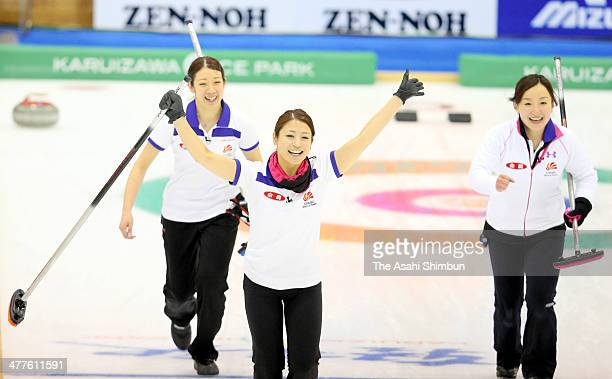 Chiaki Matsumura Miyo Ichikawa and Satsuki Fujisawa of Chubu Electric Power Co celebrate winning the final against Hokkaido Bank during the 31st All...