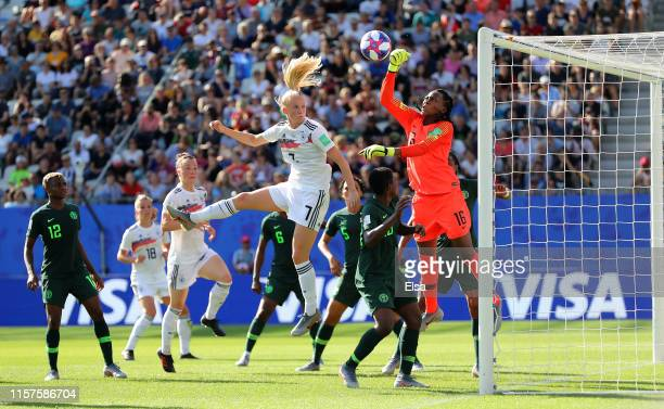 Chiamaka Nnadozie of Nigeria punches the ball clear from Lea Schueller of Germany during the 2019 FIFA Women's World Cup France Round Of 16 match...
