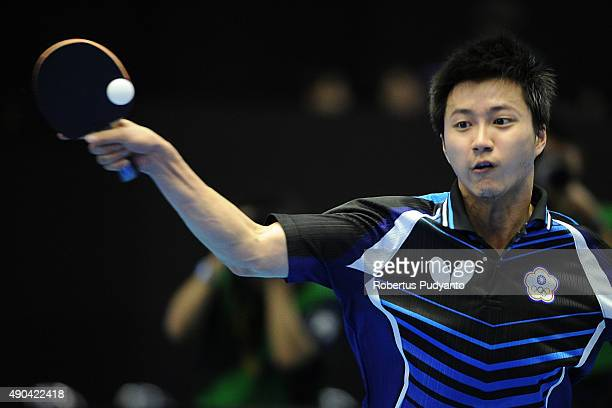 Chiang Hung-Chieh of Taipei competes against Oshima Yuya of Japan during Men's Team Champion Division semi-final match of the 22nd 2015 ITTF Asian...