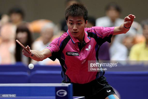 Chiang Hung-Chieh of Taipei returns a shot against Yu Ziyang of China during their Men's Singles Quarter final match on day two of 2014 ITTF World...