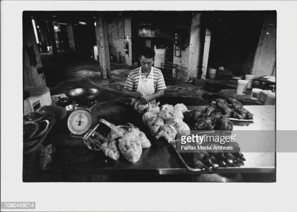 Chiang Kee Wong prepares food for the Chinese new year below the Marigold Chinese Restaurant in China Town February 8 1994