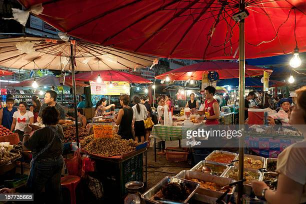 chiang mai night bazaar, thailand - chiang mai province stock photos and pictures