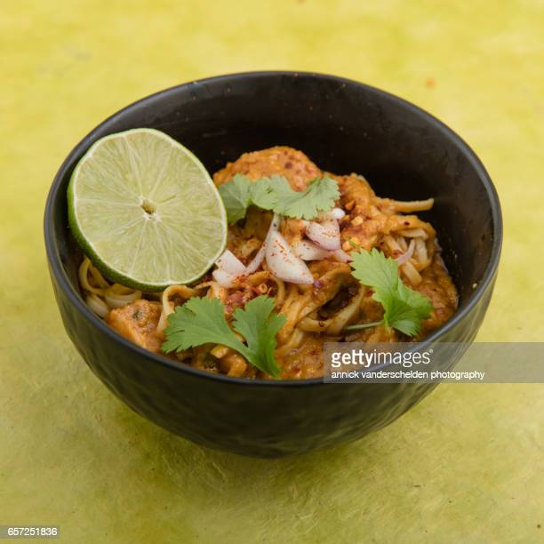 chiang mai noodles soup kao soi. - curry soup stock photos and pictures