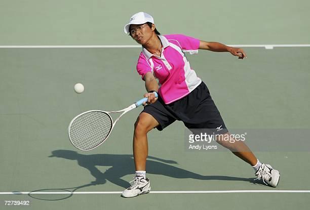 Chiang Wan Chi of Chinese Taipei plays a shot in her match over Kim Ji Eun of the Republic of Korea in the Women's Soft Tennis Singles semi final...