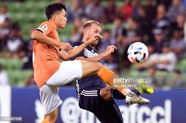 Chiangrai United's Piyaphon Phanitchakun tackles Melbourne Victory's Ola Toivonen during their AFC Champions League football match in Melbourne on...