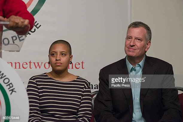 Chiara and her father Bill de Blasio listen as Al Sharpton speaks New York City Mayor Bill de Blasio and his daughter Chiara joined Reverend Al...