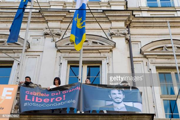 Chiara Appendino mayor of Turin shows a banner from town hall to demand freedom for Gabriele Del Grande during a rally to demand the release of the...