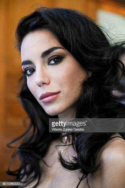 Chiara Biasi poses for photographs at L'Oreal Professionnel backstage during the 73rd Venice Film Festival on September 8 2016 in Venice Italy