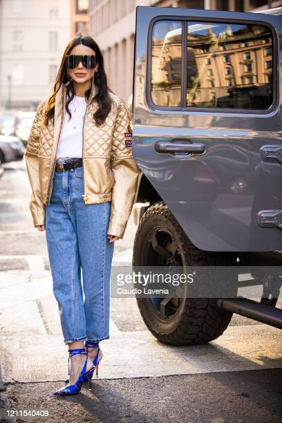 Chiara Biasi wearing a white top gold jacket blue jeans and blue printed heels is seen outside Philosophy di Lorenzo Serafini show during Milan...