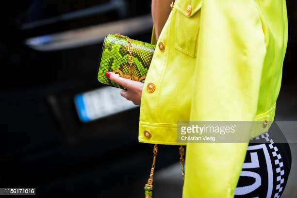 Chiara Capitani is seen wearing dress cropped neon jacket outside Versace during the Milan Men's Fashion Week Spring/Summer 2020 on June 15 2019 in...