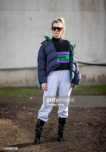 Chiara Capitani is seen wearing jogger pants navy down feather jacket jumper black boots outside Lacoste during Paris Fashion Week Womenswear...
