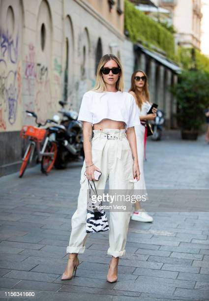 Chiara Capitani is seen wearing white cropped top, creme white pants, bag with zebra print outside Palm Angels during the Milan Men's Fashion Week...