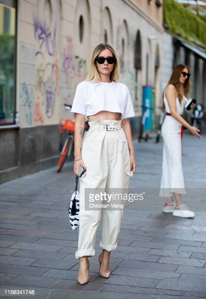 Chiara Capitani is seen wearing white cropped top creme white pants bag with zebra print outside Palm Angels during the Milan Men's Fashion Week...