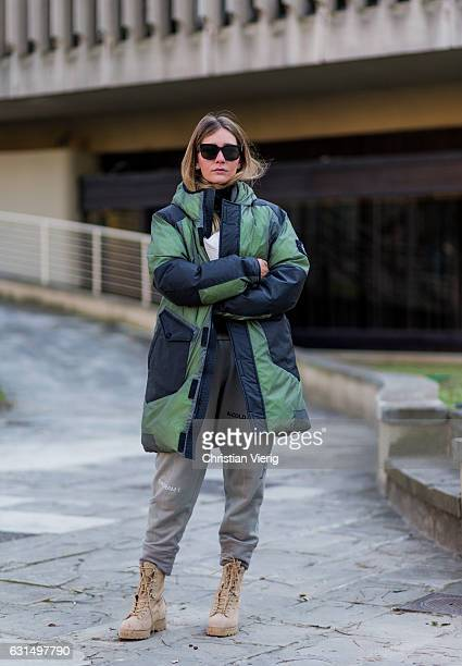 Chiara Capitani is wearing a down feather jacket jogger pants boots sunglasses on January 11 2017 in Florence Italy