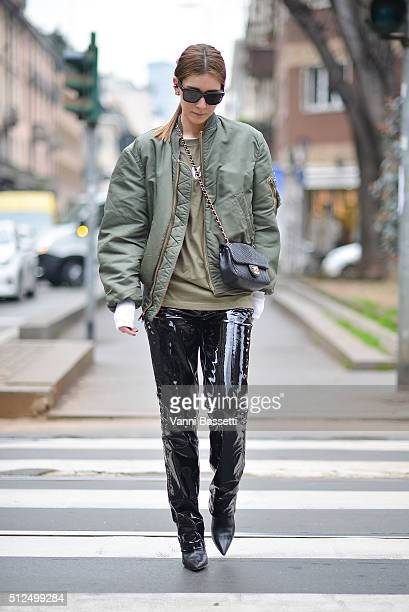 Chiara Capitani poses wearing a vintage bomber jacket Diesel Black Gold pants Chanel bag and Fucking Awesome tshirt before the Sportmax show during...