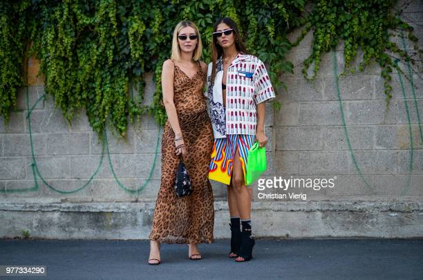 Chiara Capitani wearing leopard print dress and Gilda Ambrosio wearing Prada button skirt skirt ankle boots is seen outside Palm Angels during Milan...