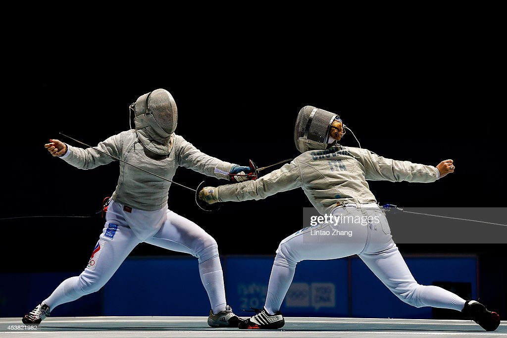 Chiara Crovari of Italy (R) and Alina Moseyko of Russia compete in the Women's Sabre Individual Final on day three of the Nanjing 2014 Summer Youth Olympic Games at Nanjing International Expo Centre on August 19, 2014 in Nanjing, China.