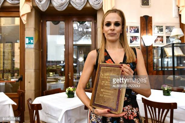 Chiara Cuomo shows the guestbook from the 1950's at the Il Vero Alfredo Restaurant in Rome on February 7 2018 as it celebrates 110 years of its...